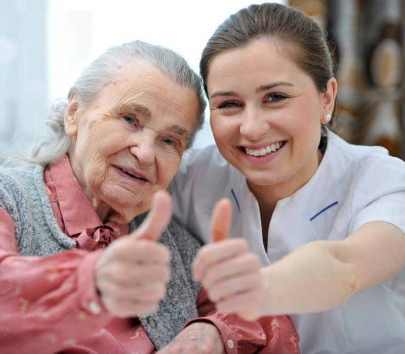 old-lady-and-carer-giving-thumbs-up-900px